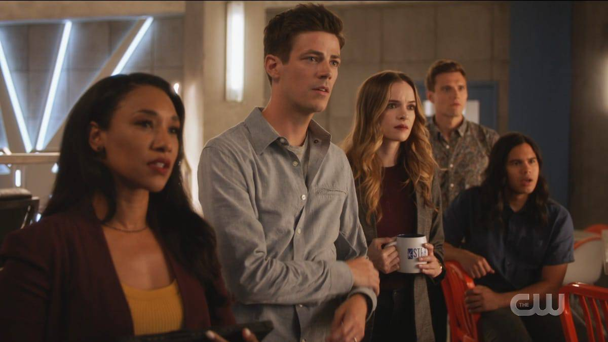 Iris, Barry, Caitlin, Ralph, and Cisco watch a shocking video on The Flash season six. Pic credit: The CW
