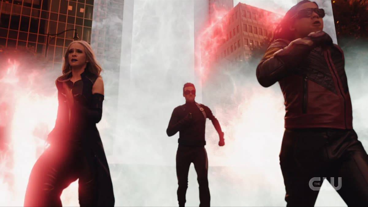 Team Flash members Killer Frost, Ralph, and Cisco run from destruction. Pic credit: The CW
