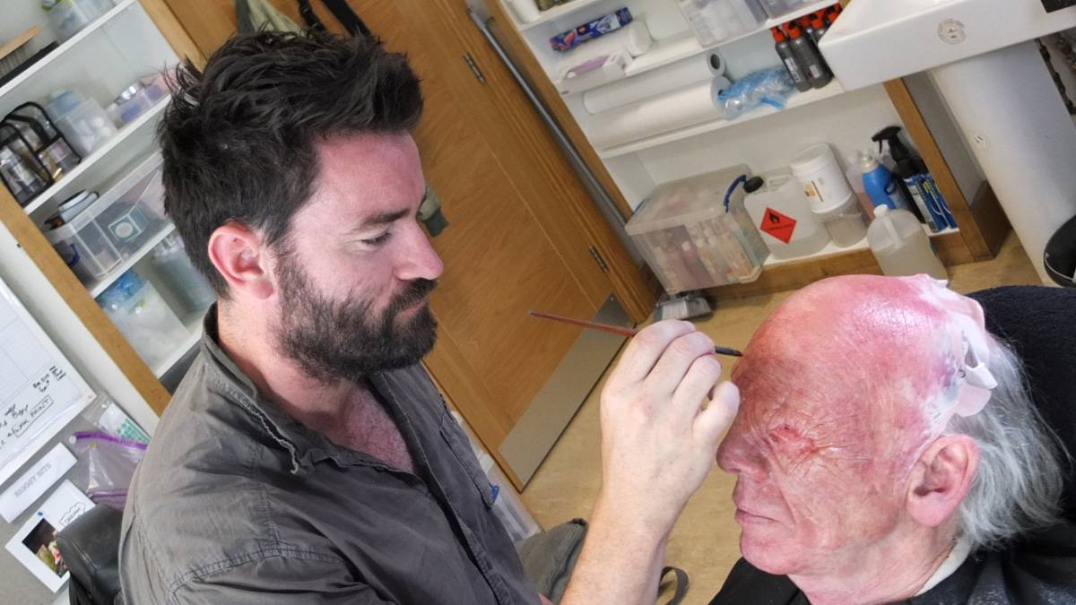 John Kavanagh in chair being transformed into The Seer for Vikings by Tom McInerney. Pic credit: History.