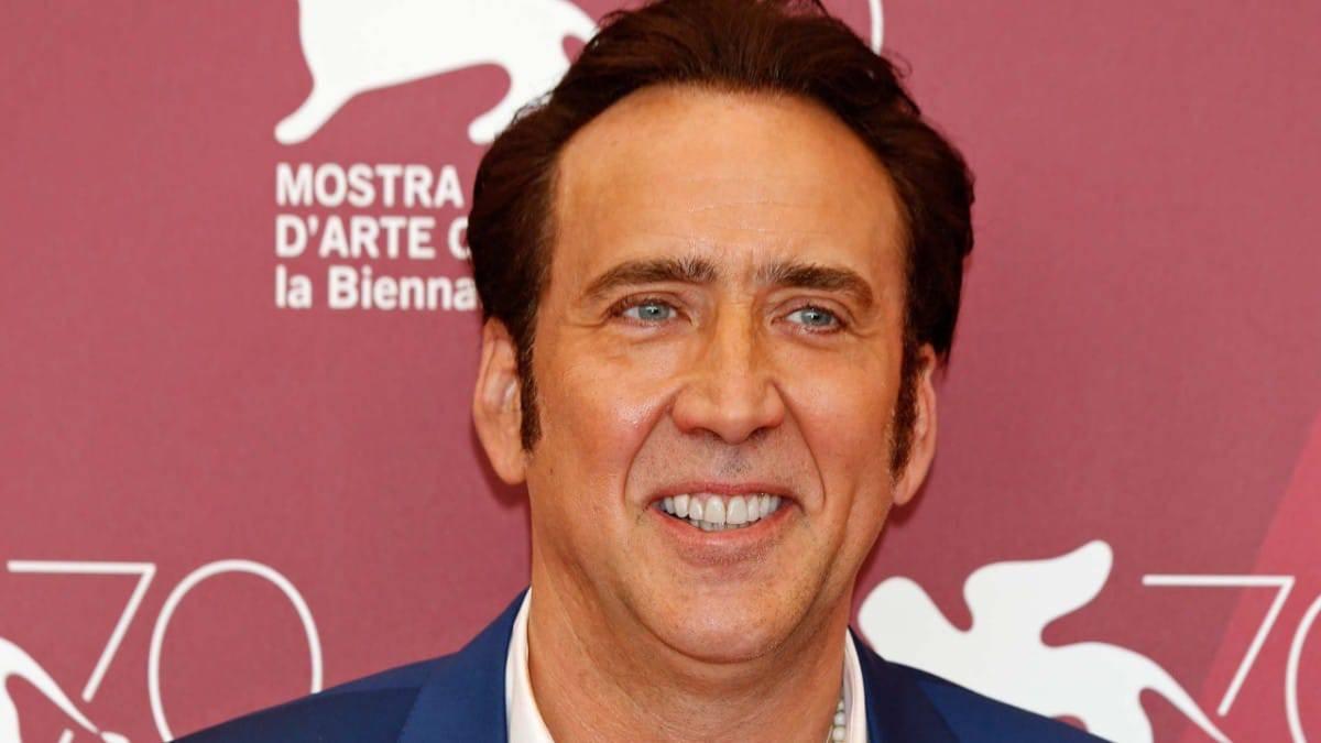 Nicolas Cage posing at a film awards
