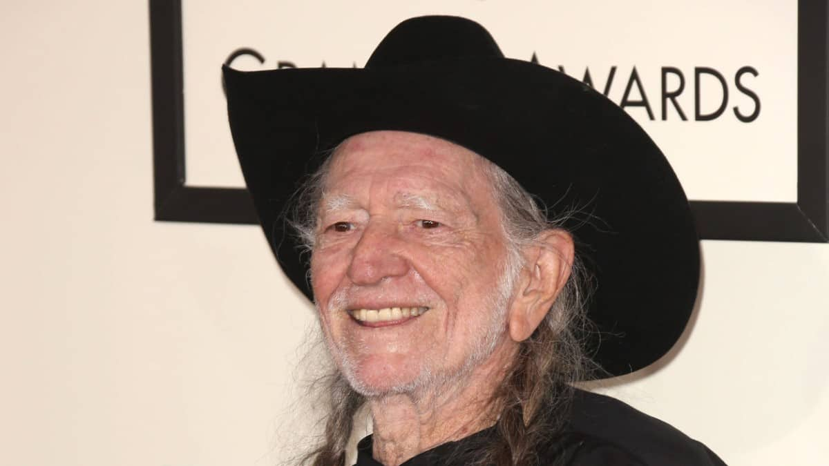Willie Nelson posing at the 56th Grammy Awards