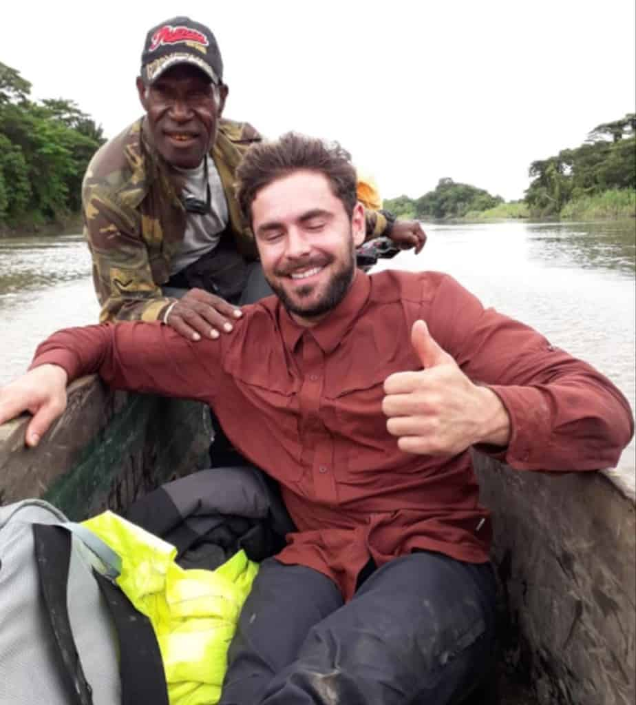 Zac Efron in a boat with PNG tour guide