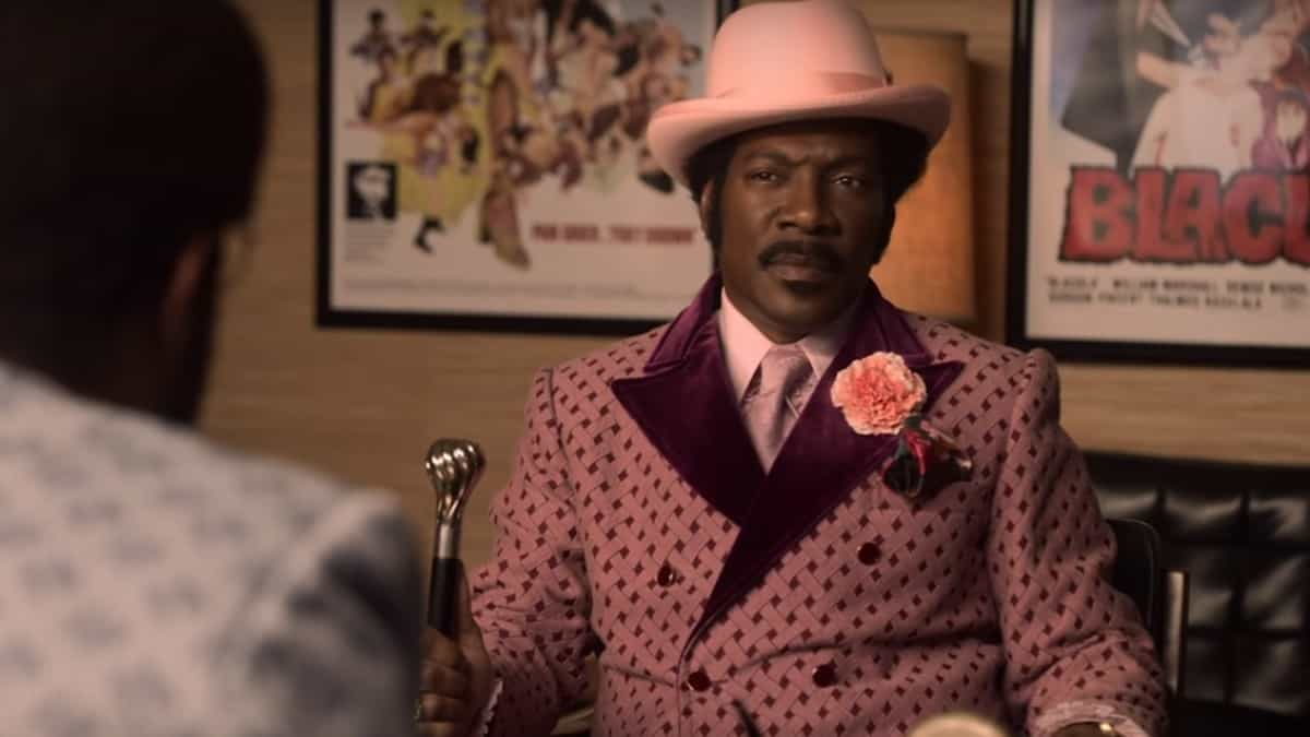 Eddie Murphy portraying Rudy Ray Moore dressed as Dolemite