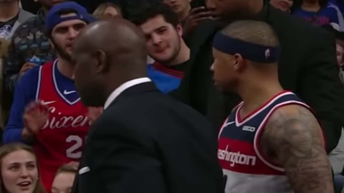 wizards guard isaiah thomas confronts fan in stands at wells fargo center