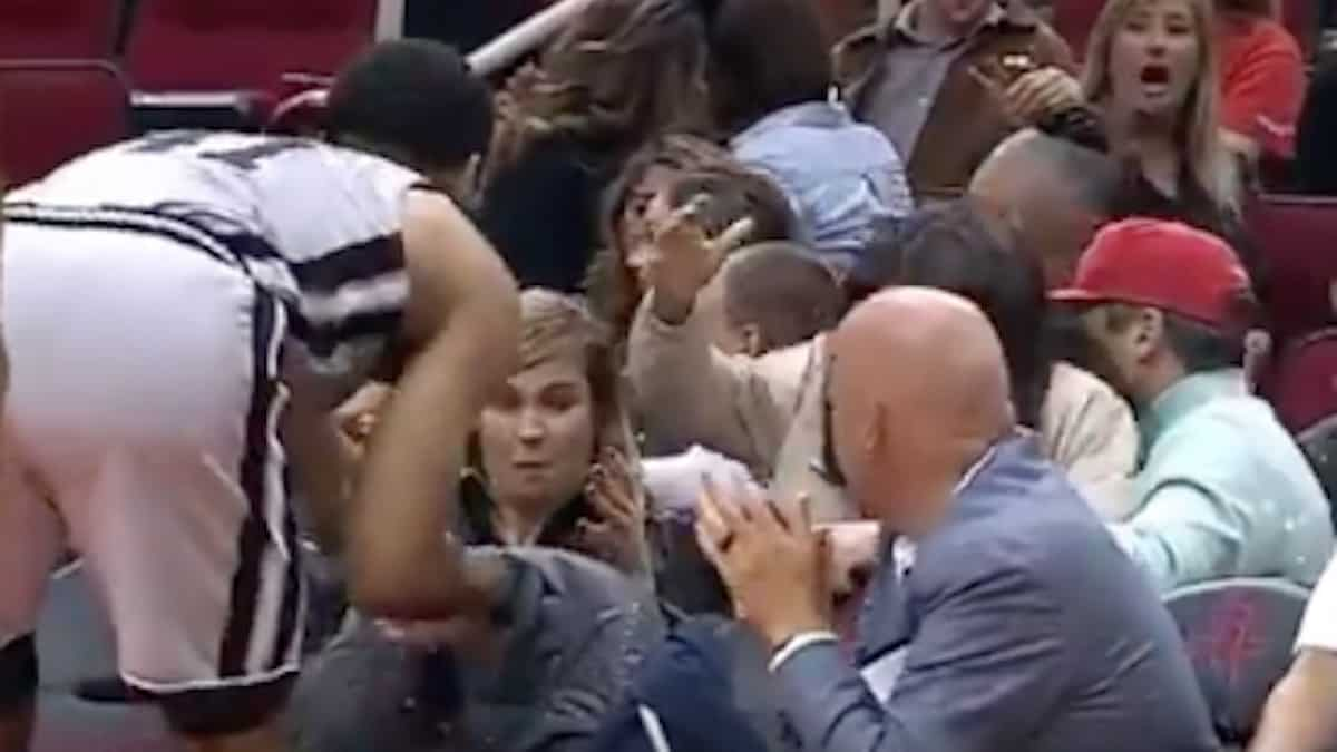 trey lyles splashes a fans beer as he tries to get the ball back