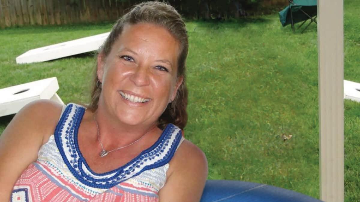 Cheryl Coker sitting in Backyard