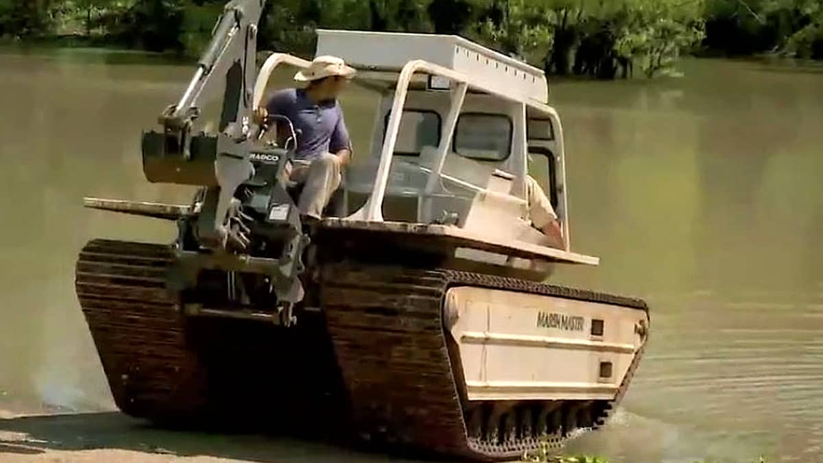 Would you drive this into gator infested waters? With three big men on board? Not me. Pic credit: History.