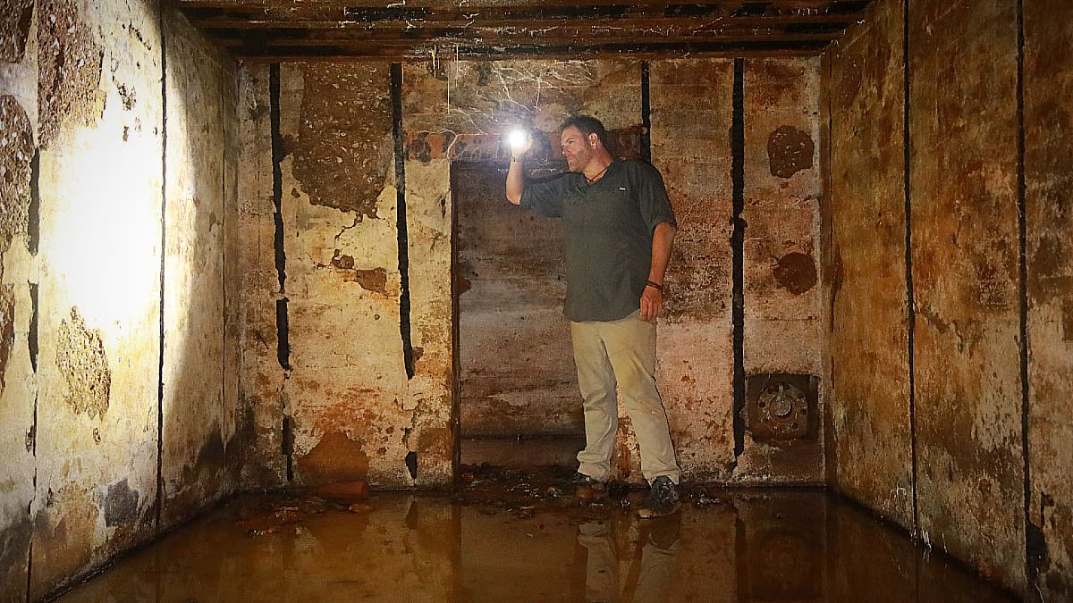 Gates here shown inside an unearthed Nazi bunker off Maisy Beach. Pic credit: Discovery.