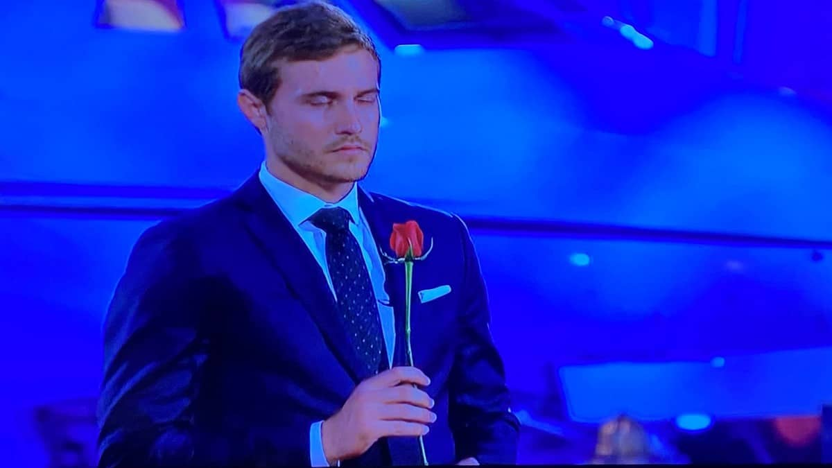 In The Bachelor season 24 episode 8, Peter holds a rose with his eyes clothed