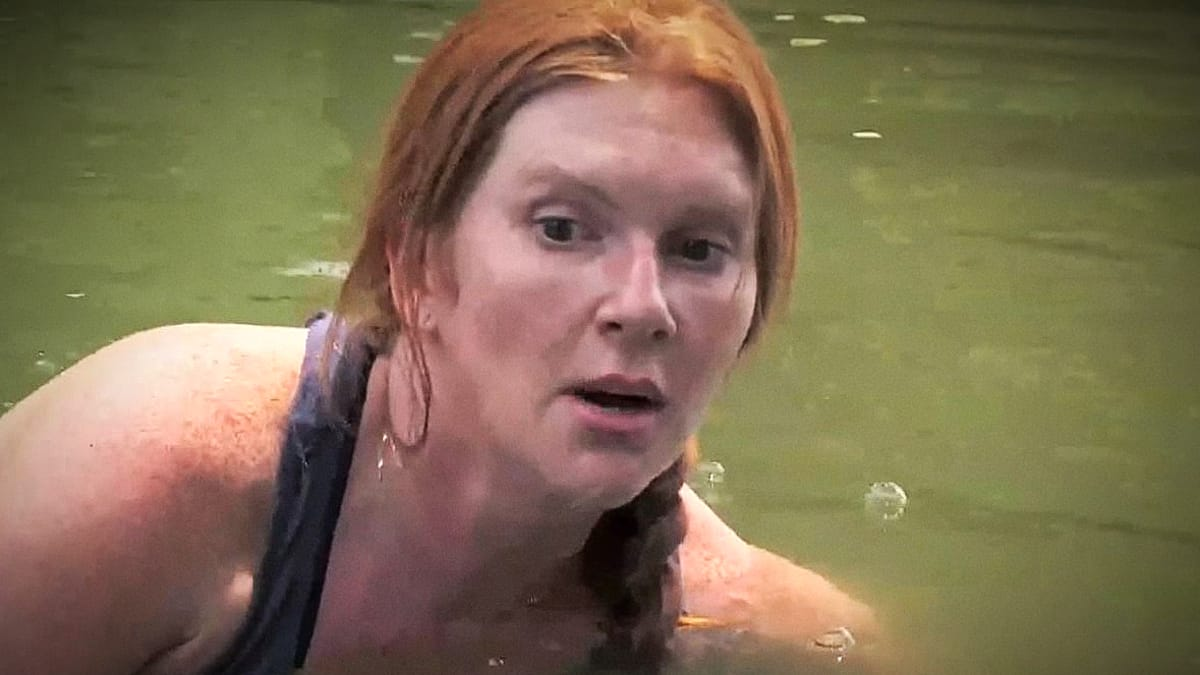 This is Ashley Dead Eye Jones feeling with her hands in the gator infested swamp for her gun. Top that. Pic credit: History.
