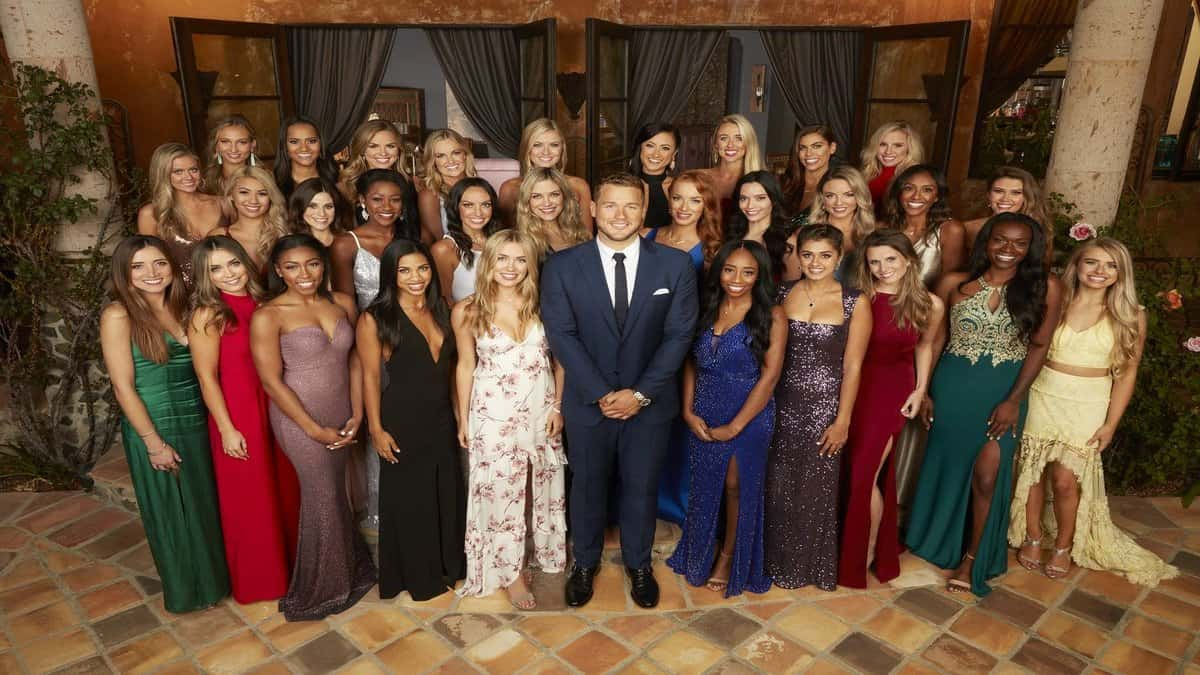 The Bachelor for season 24 episode 8, Peter Weber, poses with all the contestants