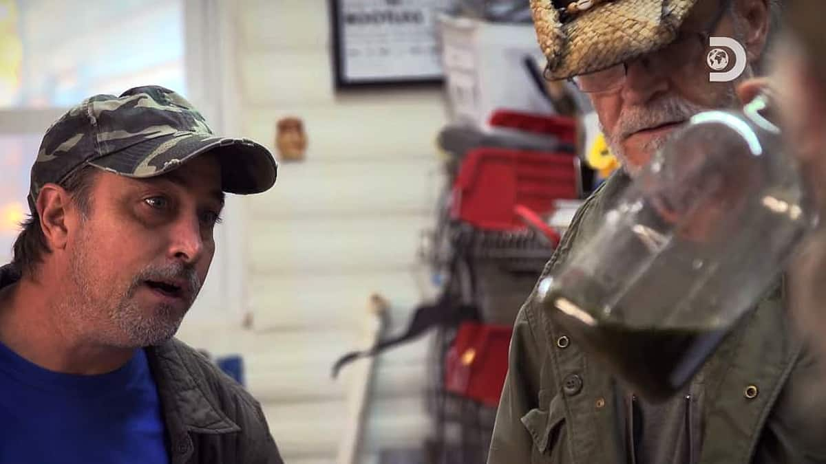 Tickle tells the guys the CBD mix is like a frog's green butt, and the experiment on Moonshiners begins. Pic credit: Discovery.