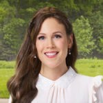 Erin Krakow as Elizabeth Thatcher Thornton on When Calls the Heart