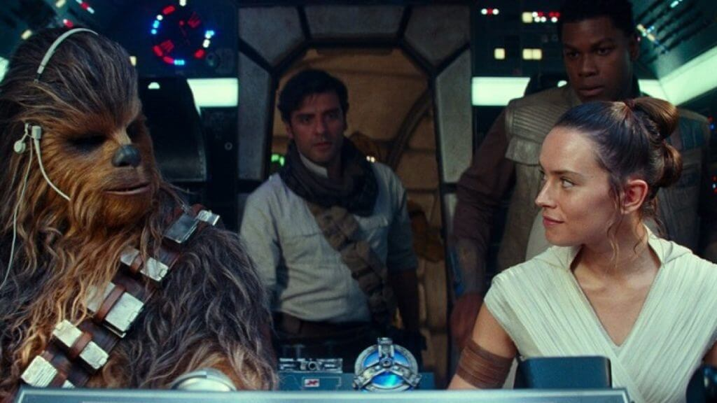 Cast members from The Rise of Skywalker enter the cockpit of The Millenium Falcon