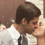 Derick Dillard and Jill Duggar sharing a kiss.