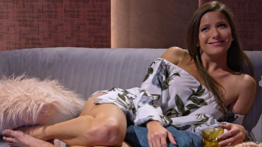 Jessica from Love is Blind lays on a couch in one of the pods