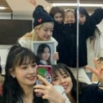 TWICE pose for a selfie