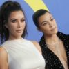 Kim Kardashian and Kourtney respond to Twitter about KUWTK fight.
