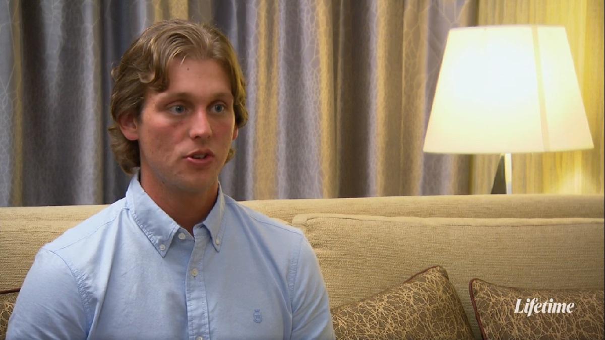 Austin wears a button up shirt