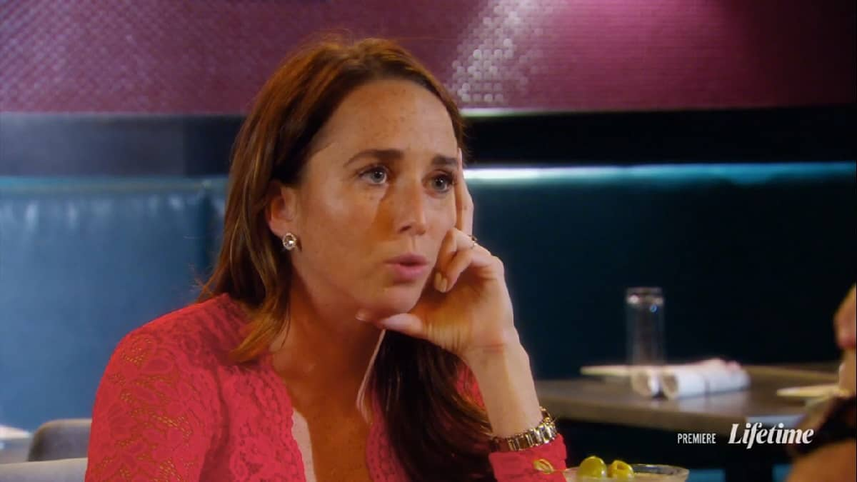 Katie looks at Derek angrily