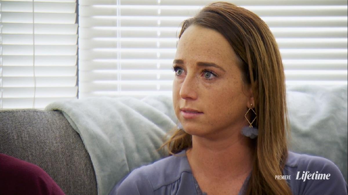 Katie looks emotional