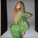 Kylie Jenner models green leopard print dress