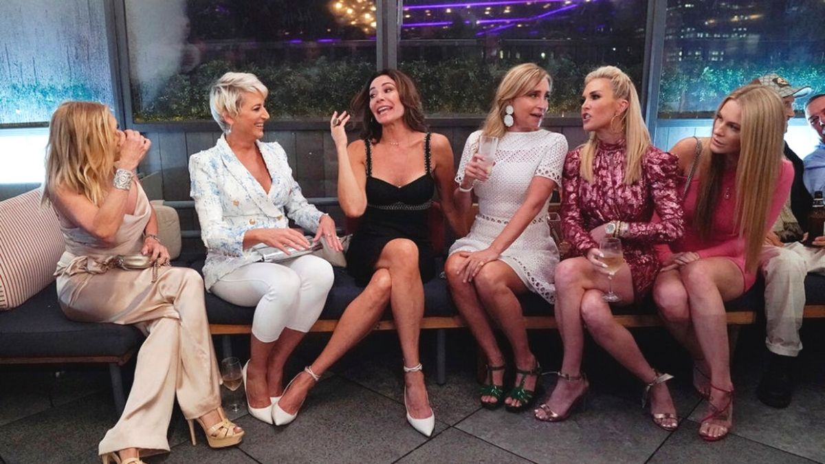 Cast members of RHONY sit on the couch