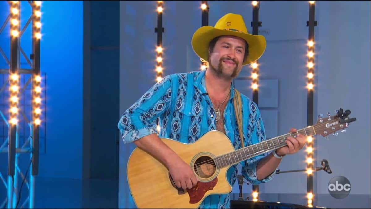 Man in yellow hat and guitar on American Idol