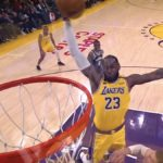 lakers lebron james soars for a dunk against milwaukee bucks