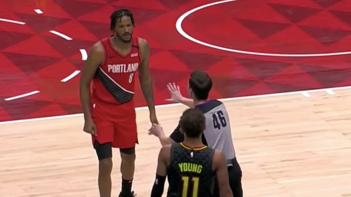 trevor ariza and trae young during nba game