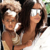 Kim Kardashian pictured getting out of a car in NYC with daughter North West Pic credit: ©ImageCollect.com/Acepixs