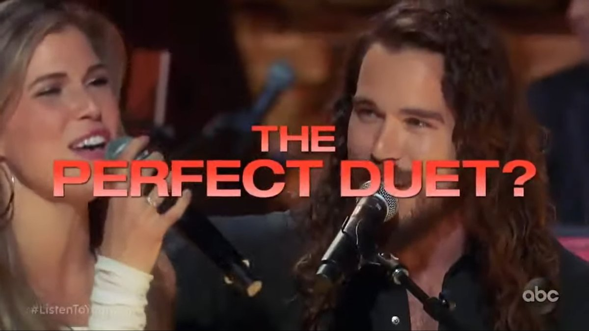 Two contestents on ABC's Listen to Your Heart perform