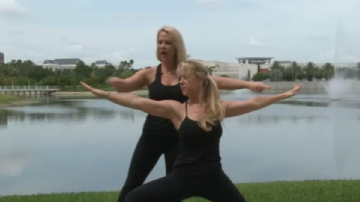 Alexandria and Anastasia Duval performing yoga