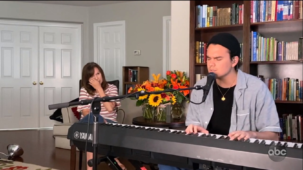 Jonny West playing piano and his mom watching