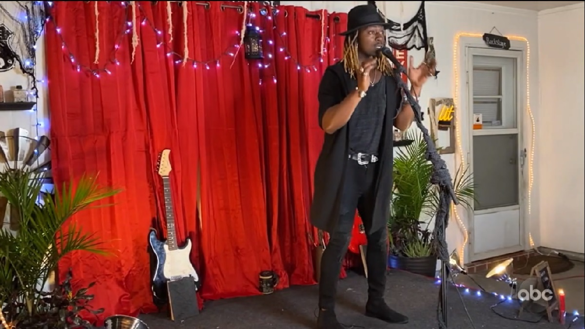 Jovin Webb singing on a homemade stage