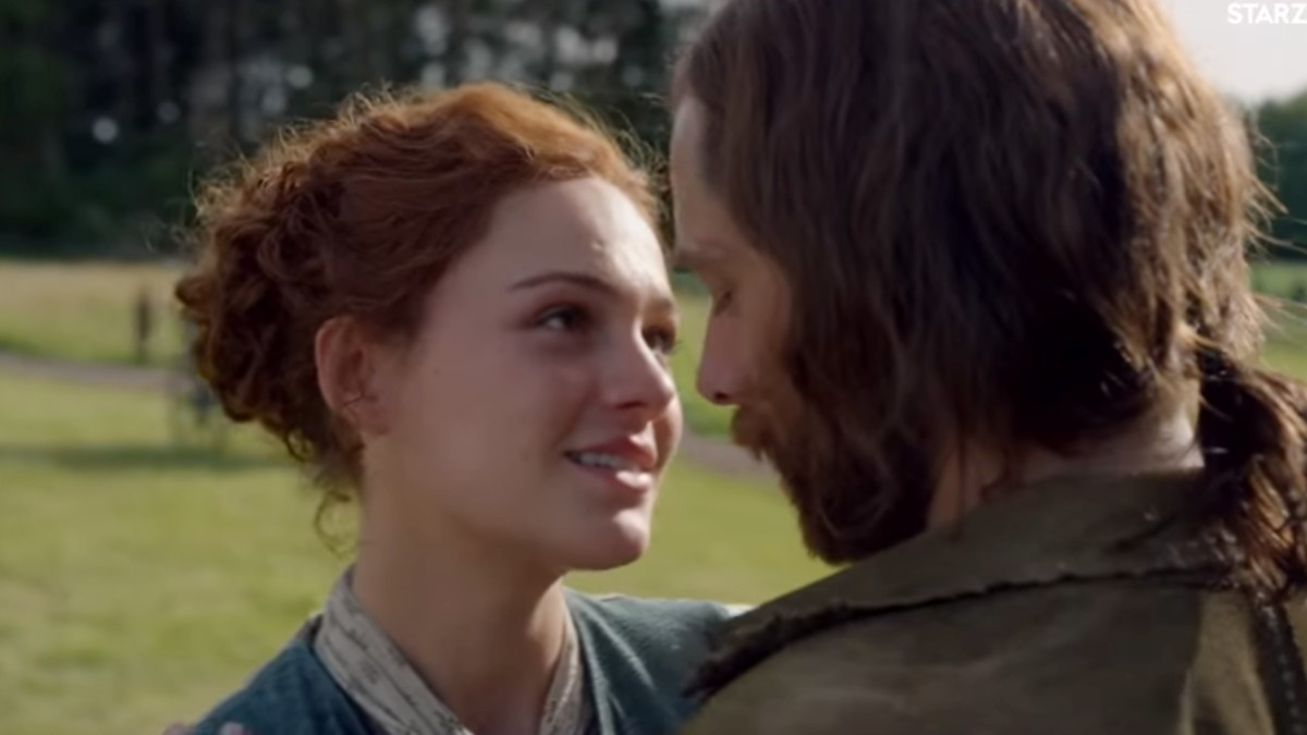Brianna and Roger embrace in a scene from Outlander