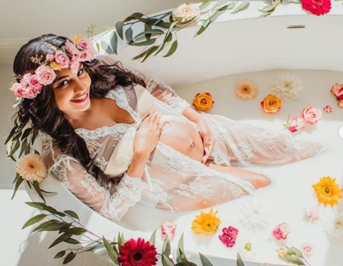 Anny poses in a bathtub filled with milk