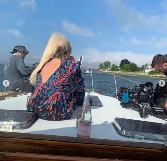 Darcey with camera crew in tow