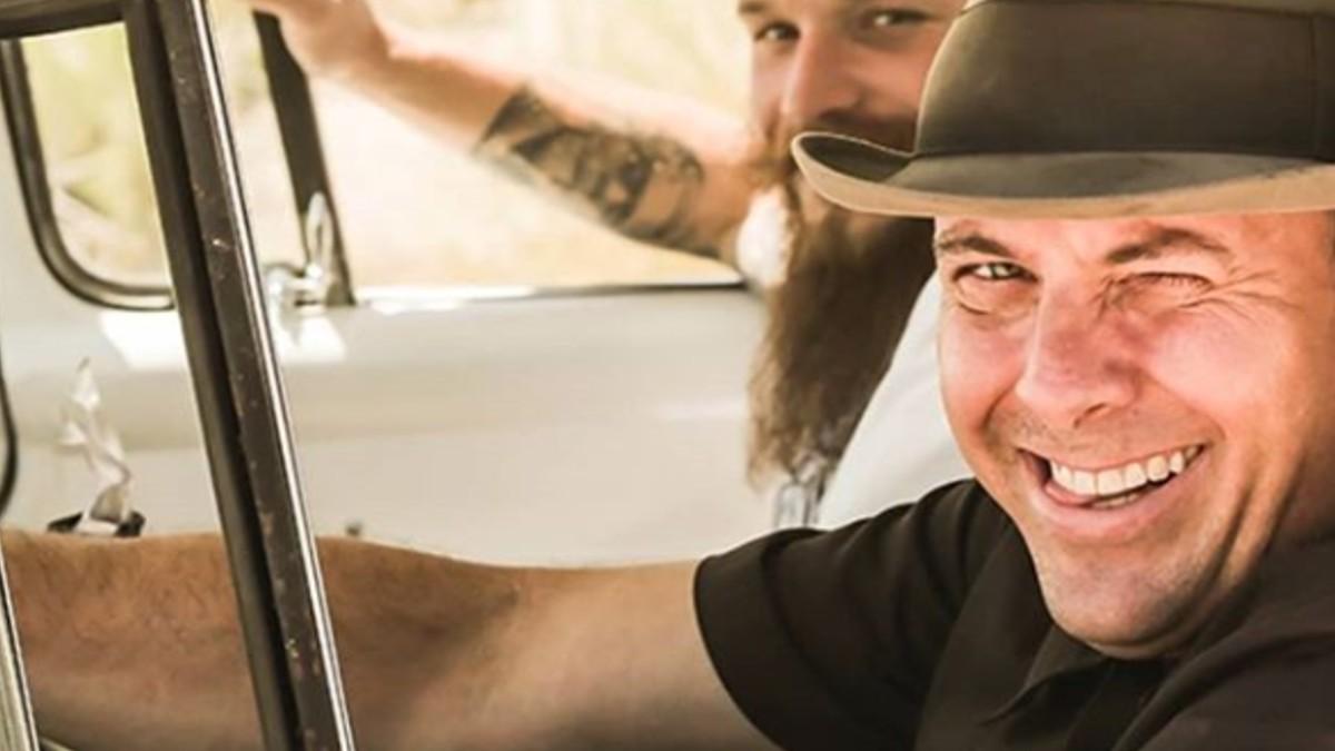 Joseph Teague smiles in a vintage car