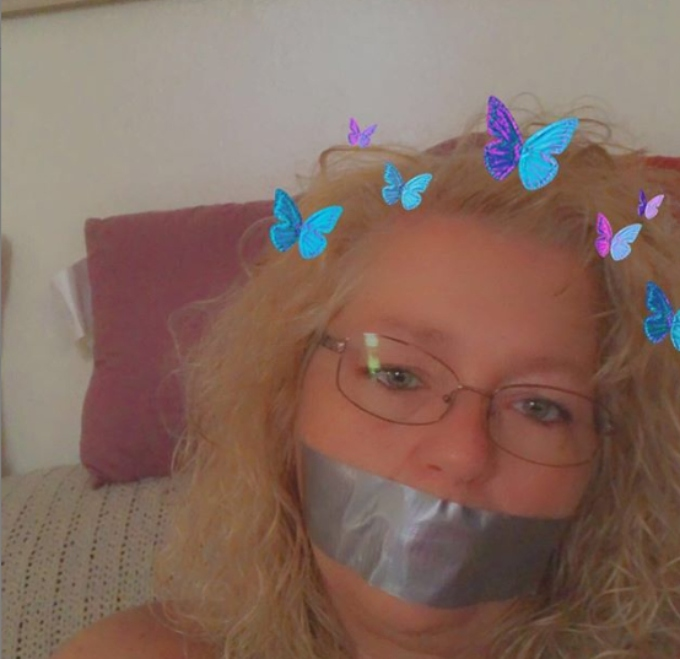 Hamme covers her mouth in duct tape