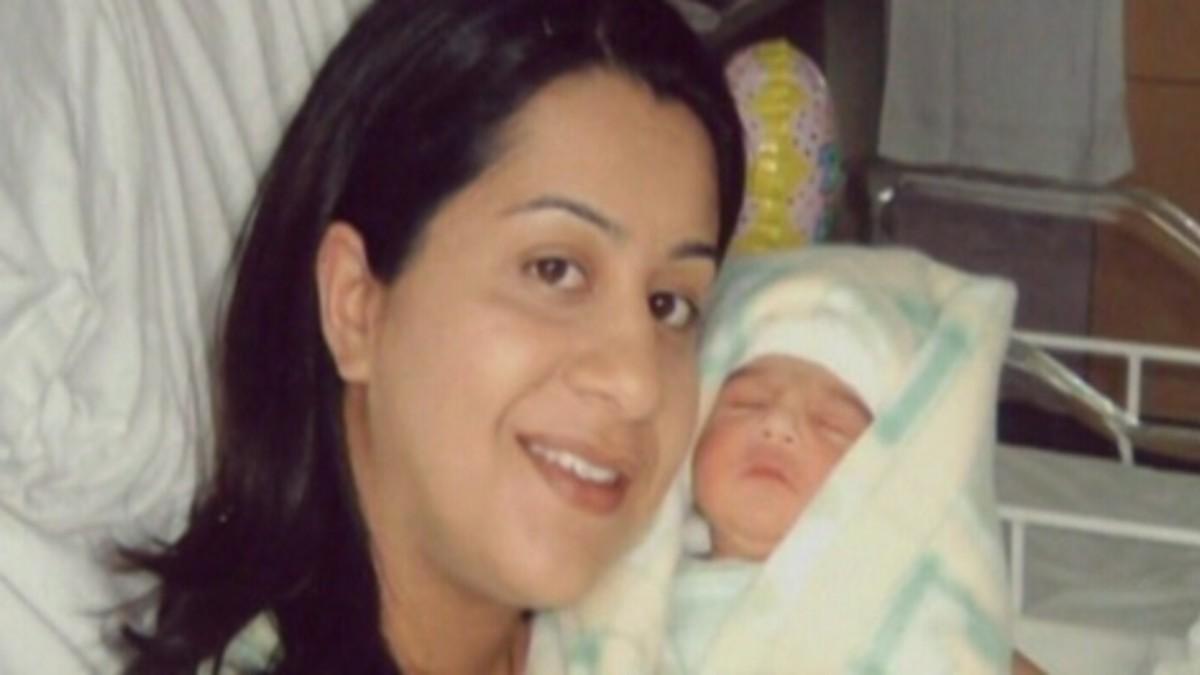 Manjit Panghali holds her newborn baby