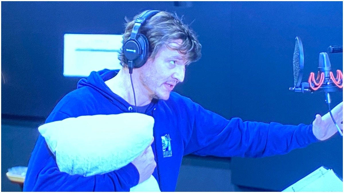 Pedro Pascal holds a pillow as he performs voiceover work for The Mandalorian