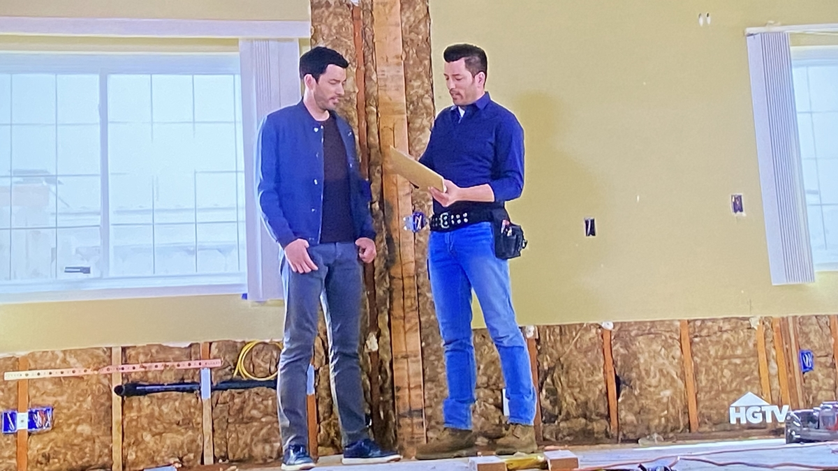 Property Brothers Drew and Jonathan Scott stand in an under-contstruction house on Property Brothers Forever Home.