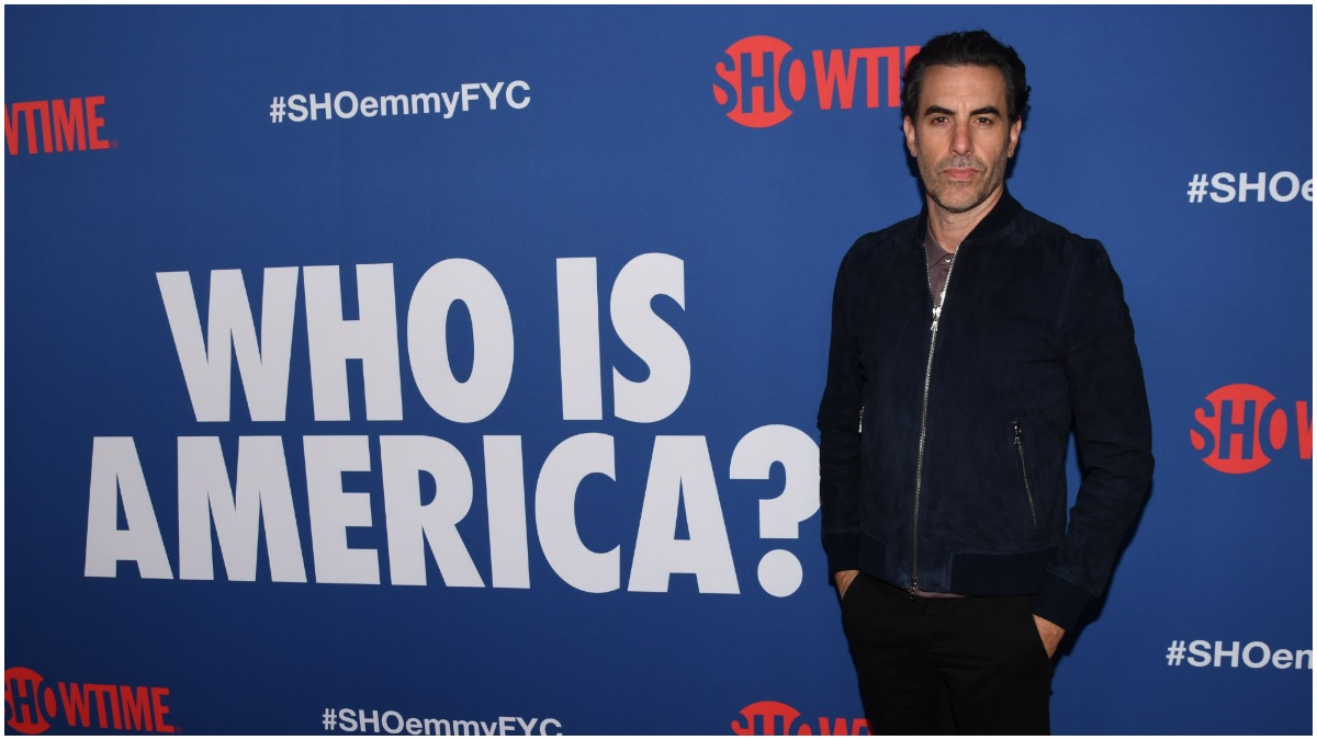 Sacha Baron Cohen trolls 3% event in Olympia, Washington, with 'Wuhan Flu' singalong