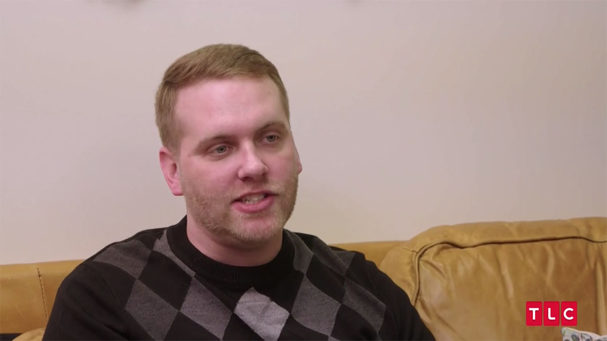 90 day fiance Tim sitting on couch