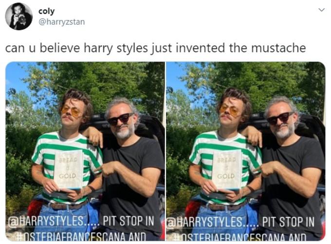 Harry Styles posing at an Italian restaurant