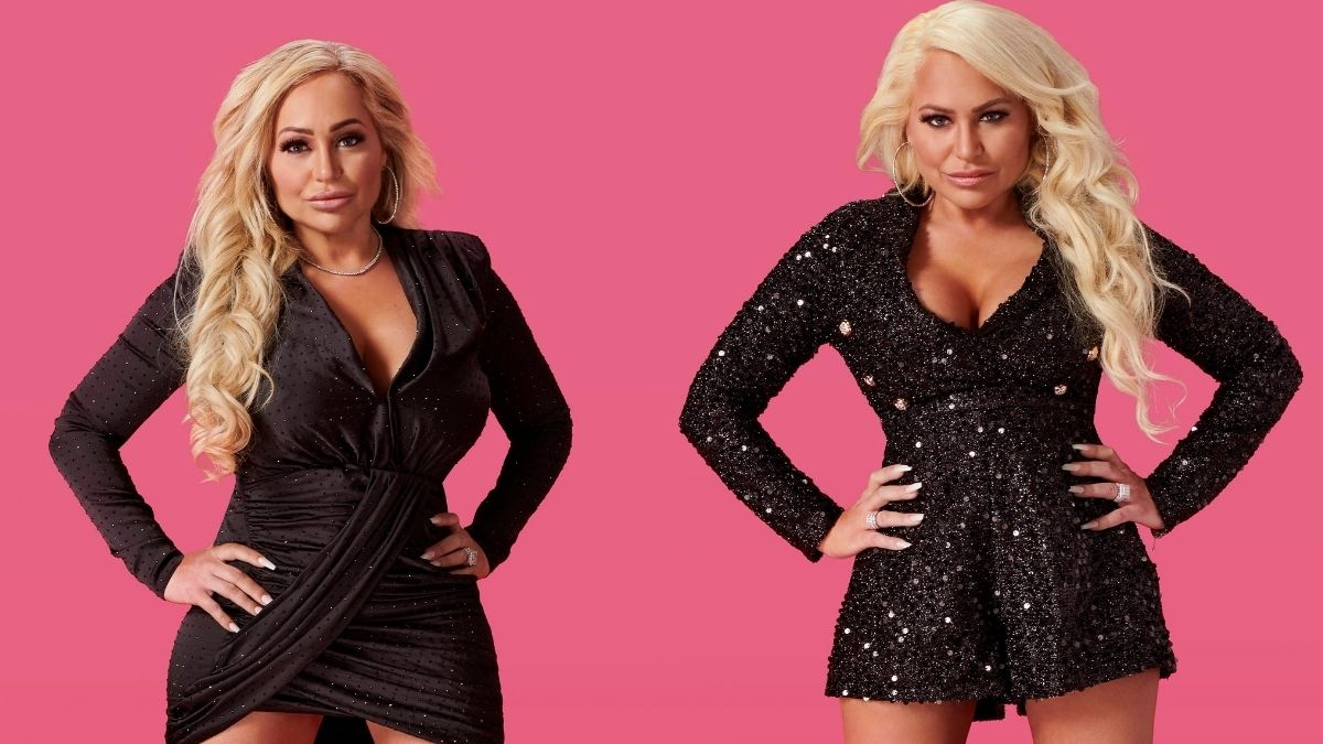 Darcey and Stacey Silva pose together in black dresses