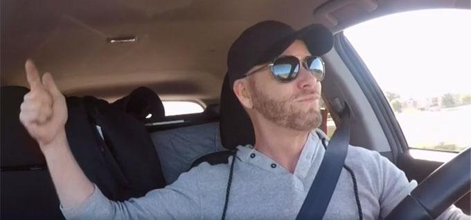 Kenneth dancing in car