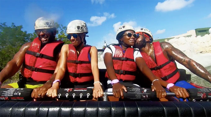MAFS Season 11 couples Woody and Amani and Miles and Karen smiling on a speedboat