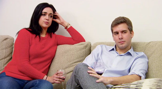 MAFS couple Henry and Christina sitting on counch unhappy